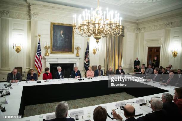US President Donald Trump center speaks during an American Workforce Policy Advisory board meeting in the State Dining Room of the White House in...