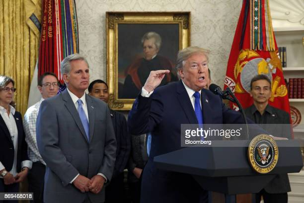 US President Donald Trump center speaks during an announcement in the Oval Office of the White House in Washington DC US on Nov 2 2017 Broadcom Ltd...