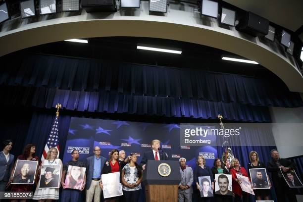 US President Donald Trump points while speaking during an event with families who have lost relatives to crimes caused by illegal immigrants at the...
