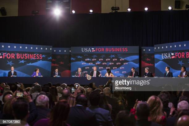 US President Donald Trump center speaks during roundtable discussion on tax cuts for Florida small businesses in Hialeah Florida US on Monday April...