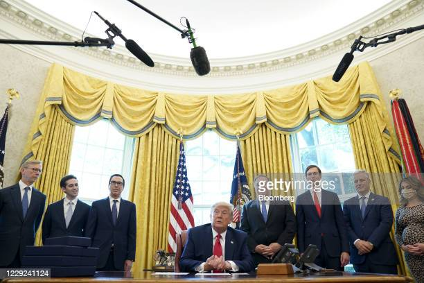 President Donald Trump, center, speaks on a conference call with leaders of Israel and Sudan during a news conference in the Oval Office of the White...