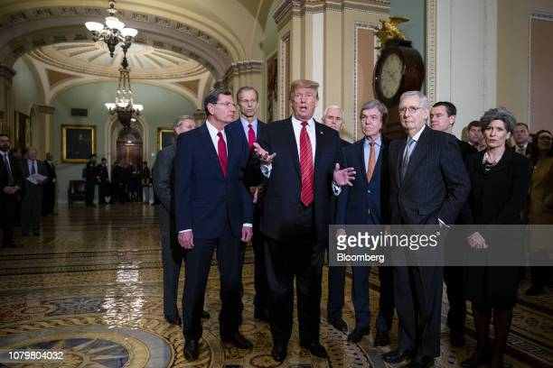 President Donald Trump, center, speaks to members of the media following a Senate Republicans policy luncheon at the U.S. Capitol in Washington,...