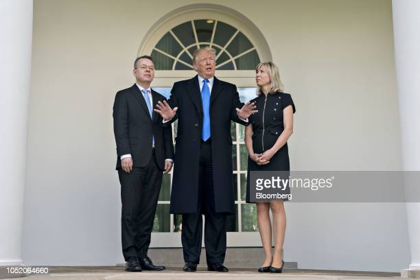 US President Donald Trump center speaks to members of the media next to US Pastor Andrew Brunson left and his wife Norine Brunson outside the Oval...