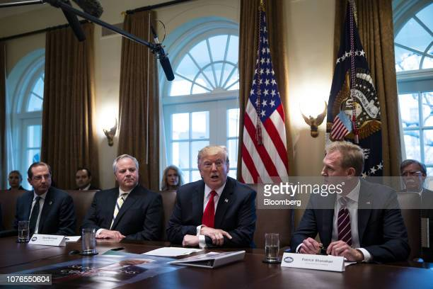 US President Donald Trump center speaks while Alex Azar secretary of Health and Human Services from left David Bernhardt acting US secretary of...