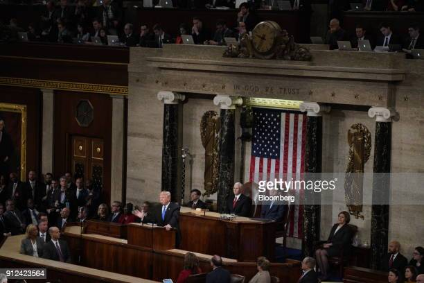 US President Donald Trump center speaks while delivering a State of the Union address to a joint session of Congress at the US Capitol in Washington...