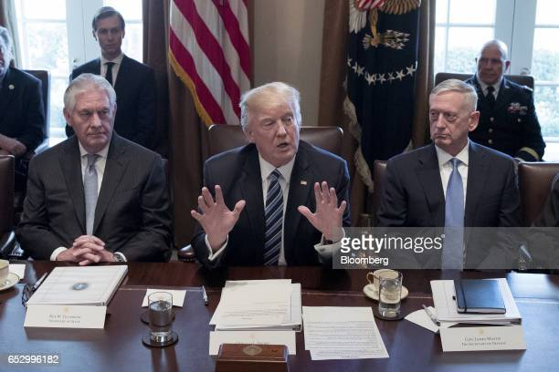US President Donald Trump center speaks while James Mattis US secretary of defense right and Rex Tillerson US secretary of State listen during a...