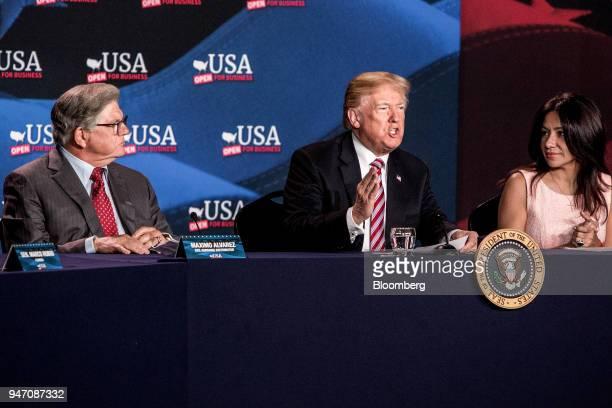 US President Donald Trump center speaks while Maximo Alvarez president of Sunshine Gasoline Distributors left and Irina Vilarino owner of Las Vegas...