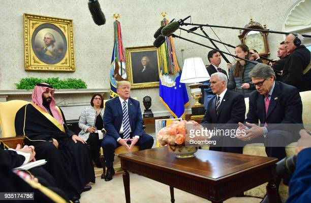 US President Donald Trump center speaks while Mohammed bin Salman Saudi Arabia's crown prince left listens during a meeting in the Oval Office of the...