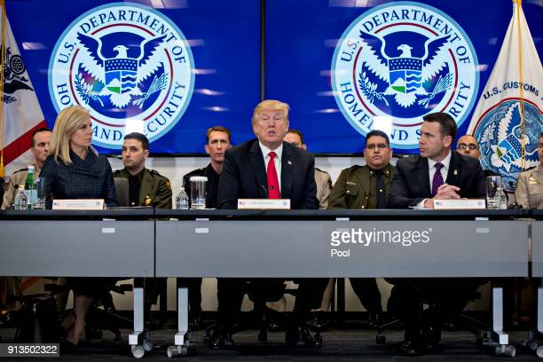 US President Donald Trump center speaks while participating in a Customs and Border Protection roundtable discussion with Kirstjen Nielsen secretary...