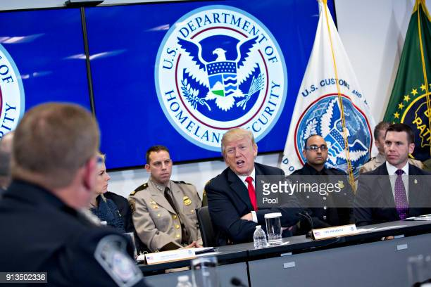 US President Donald Trump center speaks while participating in a Customs and Border Protection roundtable discussion after touring the CBP National...