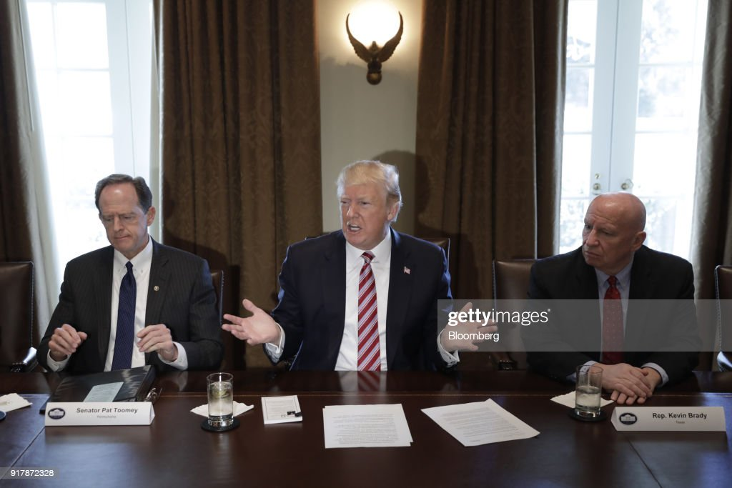 U.S. President Donald Trump, center, speaks while Representative Kevin Brady, a Republican from Texas, right, and Senator Pat Toomey, a Republican from Pennsylvania, listen during a meeting with bipartisan members of Congress on trade in the Cabinet Room of the White House in Washington, D.C., U.S., on Tuesday, Feb. 13, 2018. Republican lawmakers cautioned Trumpin a White House meeting against levying tariffs on steel and aluminum imports, warning that it would raise prices of the metals and potentially cost the U.S. jobs in other industries including car manufacturing. Photographer: Yuri Gripas/Bloomberg via Getty Images