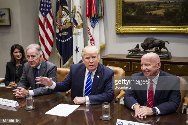 US President Donald Trump center speaks while Representative Richard Neal a Democrat from Massachusetts and ranking member of the House Ways and...