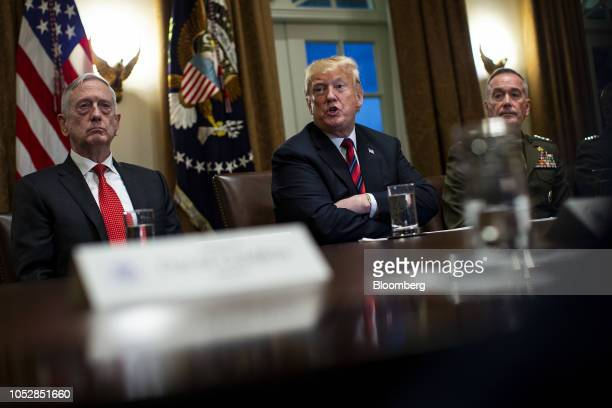 US President Donald Trump center speaks while seated next to Jim Mattis US secretary of defense left and General Joseph Dunford chairman of the Joint...