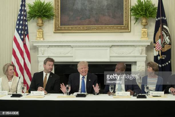 US President Donald Trump center speaks while Senator Shelley Moore Capito a Republican from West Virginia from left Senator Dean Heller a Republican...