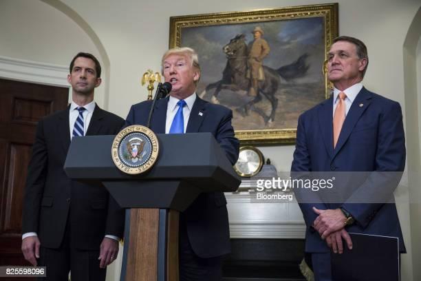 US President Donald Trump center speaks while Senator Tom Cotton a Republican from Arkansas left and Senator David Perdue a Republican from Georgia...