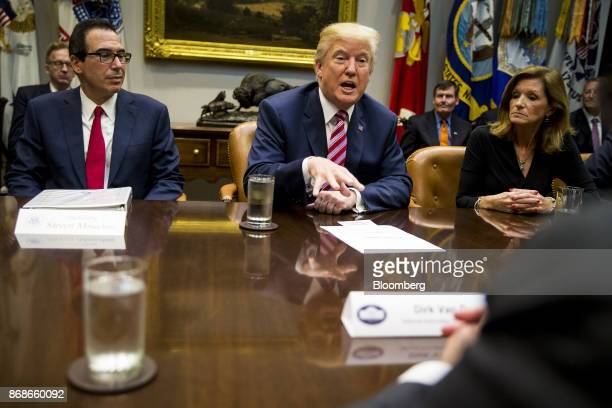 US President Donald Trump center speaks while Steve Mnuchin US Secretary of Treasury left and Karen Kerrigan president and chief executive officer of...