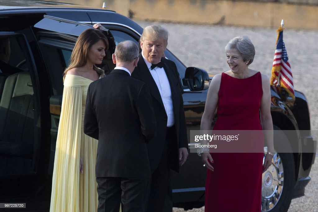 U.S. President Donald Trump, center, speaks while Theresa May, U.K. prime minister, from right, U.S. First lady Melania Trump, and Philip May, husband of May, listen ahead of a dinner at Blenheim Palace, in Oxfordshire, U.K., on Thursday, July 12, 2018. Trump and the first lady will meet British business leaders at the black-tie dinner attended by more than 100 guests. Photographer: Will Oliver/Pool via Bloomberg