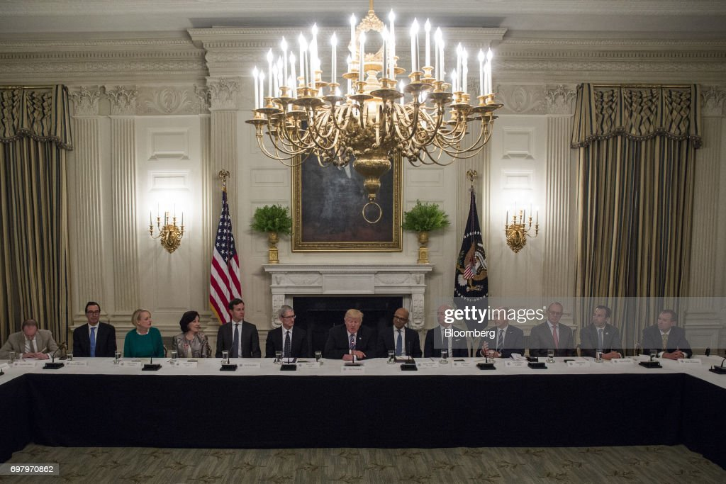 U.S. President Donald Trump, center, speaks with tech leaders during the American Technology Council roundtable hosted at the White House in Washington, D.C., U.S., on Monday, June 19, 2017. Executives from many of the world's largest technology companies gathered for the first meeting of the American Technology Council with Trumpand his senior advisers. Photographer: Zach Gibson/Bloomberg via Getty Images