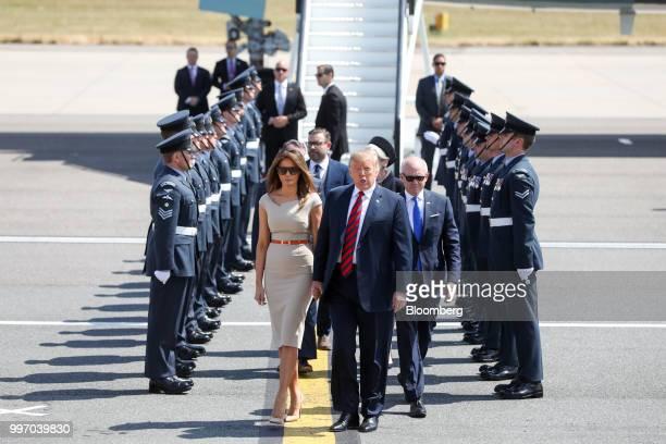 US President Donald Trump center US First Lady Melania Trump left and Woody Johnson US ambassadorto the United Kingdom make their way to Marine One...