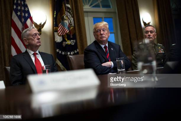 US President Donald Trump center waits to speak while seated next to Jim Mattis US secretary of defense left and General Joseph Dunford chairman of...