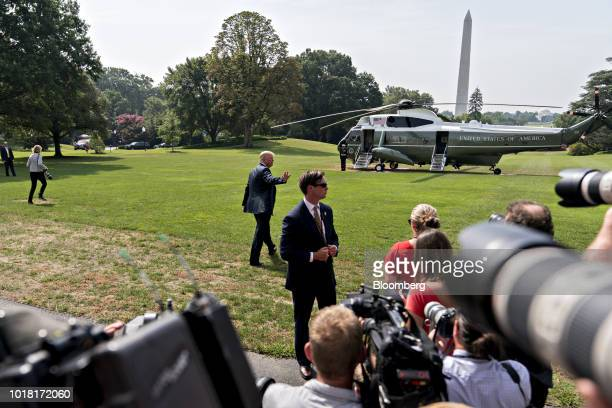US President Donald Trump center waves after speaking to members of the media before boarding Marine One on the South Lawn of the White House in...