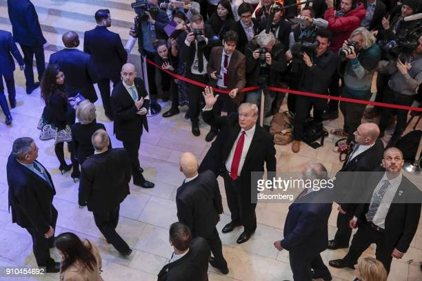 US President Donald Trump center waves as he arrives at the Congress Center on the closing day of the World Economic Forum in Davos Switzerland on...