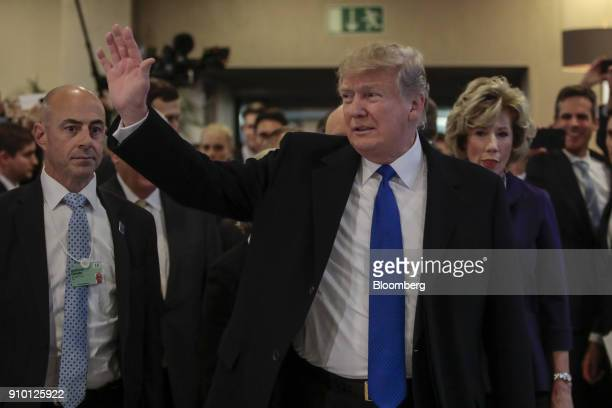 US President Donald Trump center waves as he arrives on day three of the World Economic Forum in Davos Switzerland on Thursday Jan 25 2018 World...