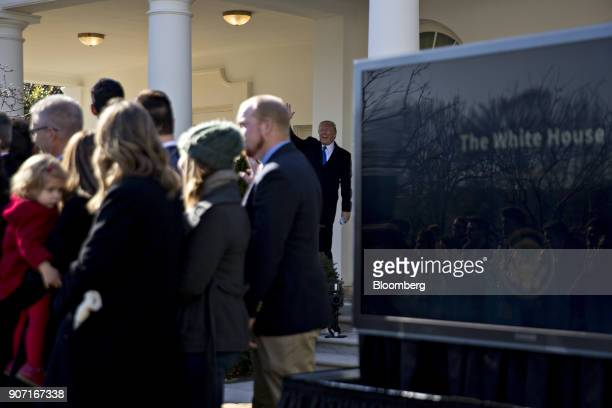 President Donald Trump, center, waves before walking into the Oval Office after addressing March for Life participants and pro-life leaders in the...