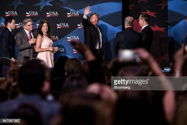 US President Donald Trump center waves to the audience while Senator Marco Rubio a Republican from Florida from left Maximo Alvarez president of...