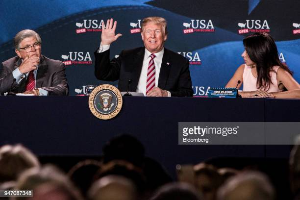 US President Donald Trump center waves while sitting next to Maximo Alvarez president of Sunshine Gasoline Distributors left and Irina Vilarino owner...