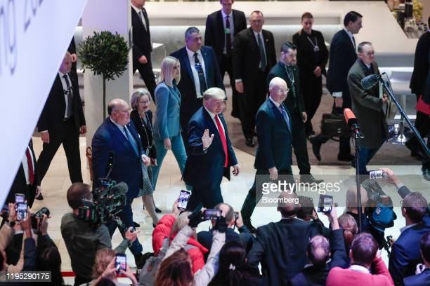 US President Donald Trump centre with Klaus Schwab chairman of the World Economic Forum and Ivanka Trump senior adviser to President Trump walk...