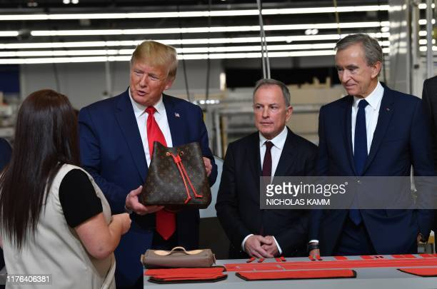 President Donald Trump , CEO of Louis Vuitton Michael Burke and Chief Executive of LVMH Bernard Arnault visit the new Louis Vuitton factory in...