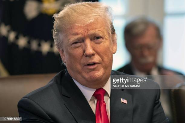US President Donald Trump chairs a Cabinet meeting at the White House in Washington DC on January 2 2019 President Donald Trump warned Wednesday the...
