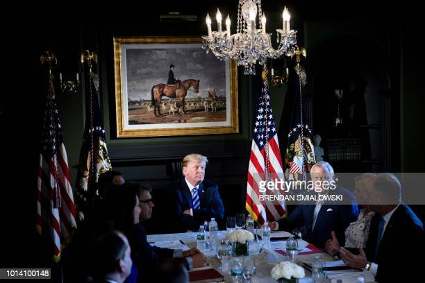 President Donald Trump chairs a meeting with administration and state officials on prison reform at the Trump National Golf Club August 9, 2018 in...