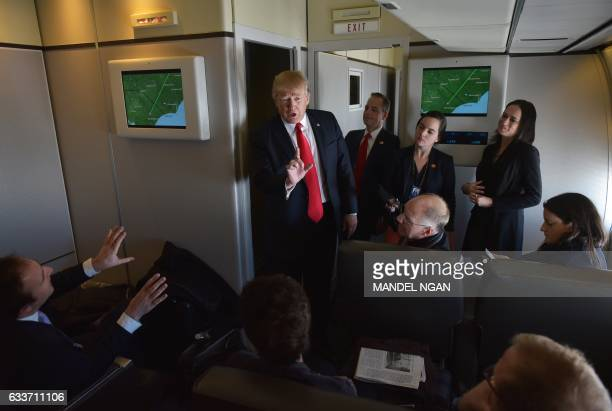 President Donald Trump chats with reporters on board Air Force One before departing from Andrews Air Force Base in Maryland bound for Palm Beach...