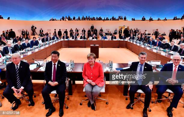 TOPSHOT US President Donald Trump China's President Xi Jinping German Chancellor Angela Merkel Argentinia's President Mauricio Macri and Australia's...