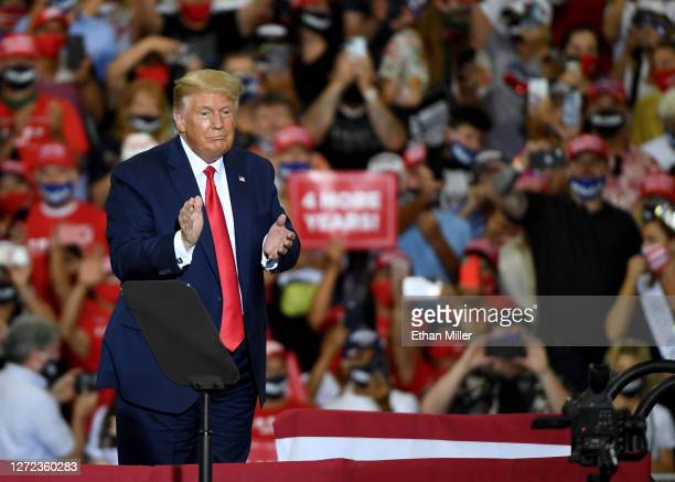 President Donald Trump claps after speaking at a campaign event at Xtreme Manufacturing on September 13, 2020 in Henderson, Nevada. Trump's visit...