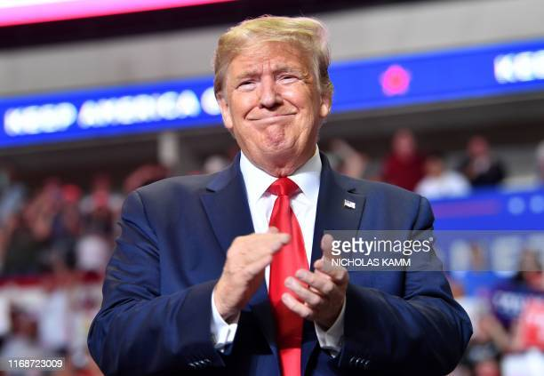 US President Donald Trump claps during a campaign rally in Rio Rancho New Mexico on September 16 2019