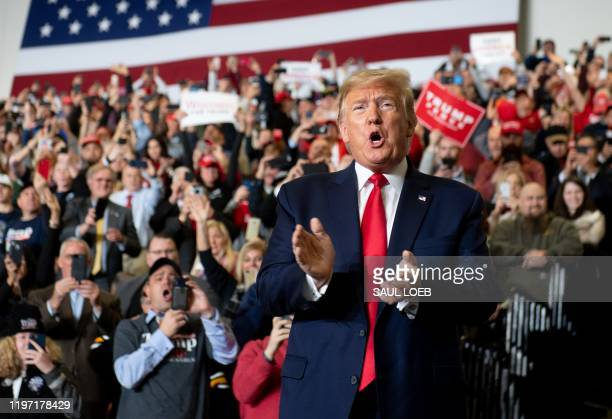 """President Donald Trump claps during a """"Keep America Great"""" campaign rally at Wildwoods Convention Center in Wildwood, New Jersey, January 28, 2020."""