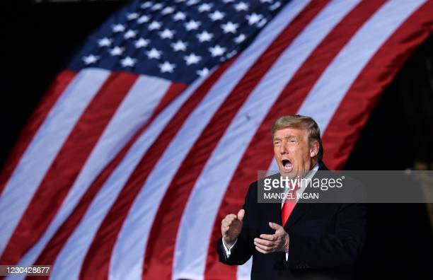 President Donald Trump claps during a rally in support of Republican incumbent senators Kelly Loeffler and David Perdue ahead of Senate runoff in...