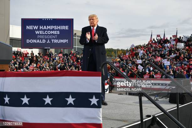 President Donald Trump claps his hands as he departs, after speaking during a campaign rally at Manchester-Boston Regional Airport in Londonderry,...