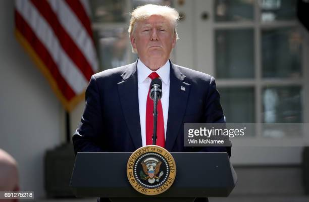 S President Donald Trump concludes his announcement to withdraw the United States from the Paris climate agreement in the Rose Garden at the White...