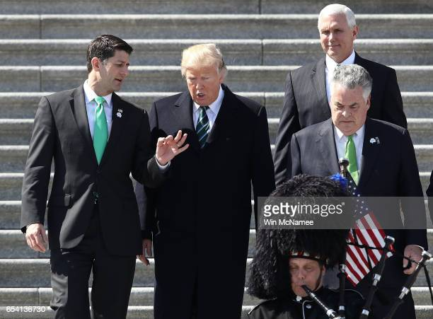 S President Donald Trump confers with US Speaker of the House Paul Ryan following a luncheon celebrating St Patrick's Day at the US Capitol on March...