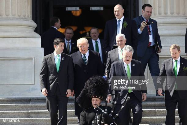 S President Donald Trump confers with US Speaker of the House Paul Ryan following a luncheon celebrating St Patrick's Day with Irish Taoiseach Enda...