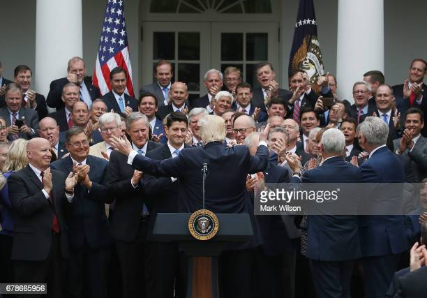 President Donald Trump congratulates House Republicans after they passed legislation aimed at repealing and replacing ObamaCare during an event in...