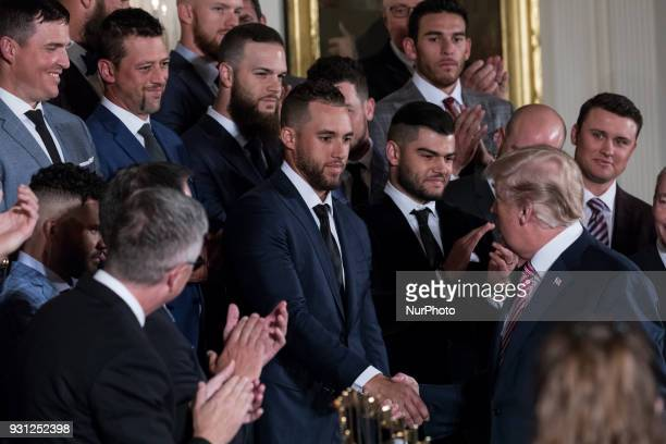 US President Donald Trump congratulates Houston Astros outfielder George Springer during the celebration of the Astros' World Series Championship in...