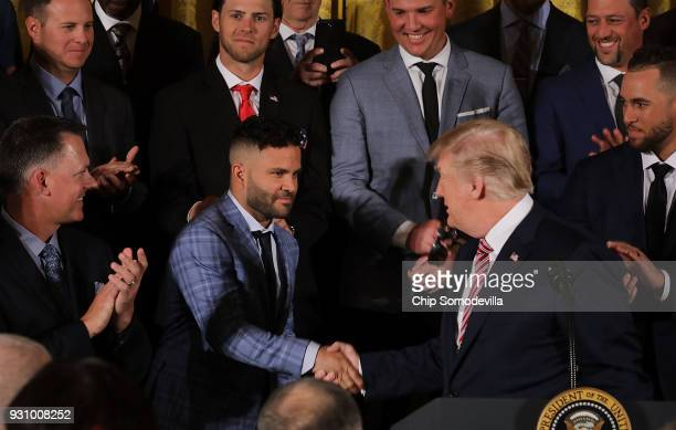 S President Donald Trump congratulates Houston Astros second baseman Jose Altuve while celebrating the team's World Series victory in the East Room...