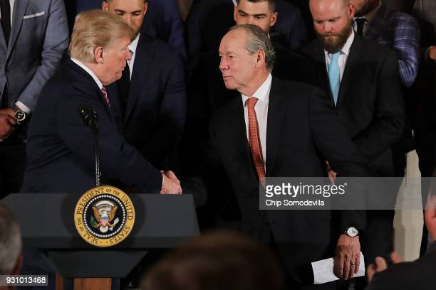 S President Donald Trump congratulates the Houston Astros owner Jim Crane while celebrating the team's World Series victory in the East Room of the...