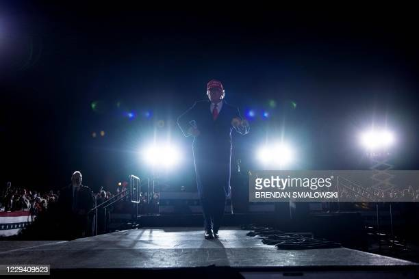 President Donald Trump dances after speaking during a Make America Great Again rally at Richard B. Russell Airport in Rome, Georgia on November 1,...