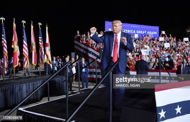 President Donald Trump dances at the end of a campaign rally at Pensacola International Airport in Pensacola, Florida on October 23, 2020.